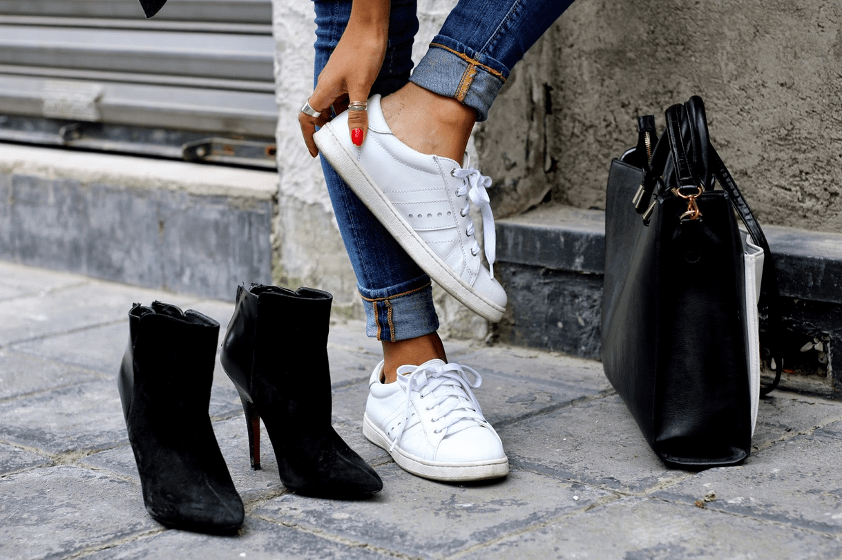 white sneakers vs high heels